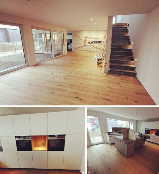 Verschiedene Raumansichten eines Neubaus mit Treppe und Küche